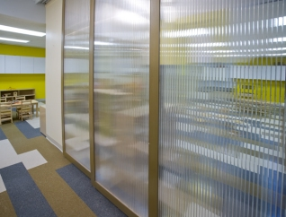 Translucent panels divide the two classrooms at the entry.